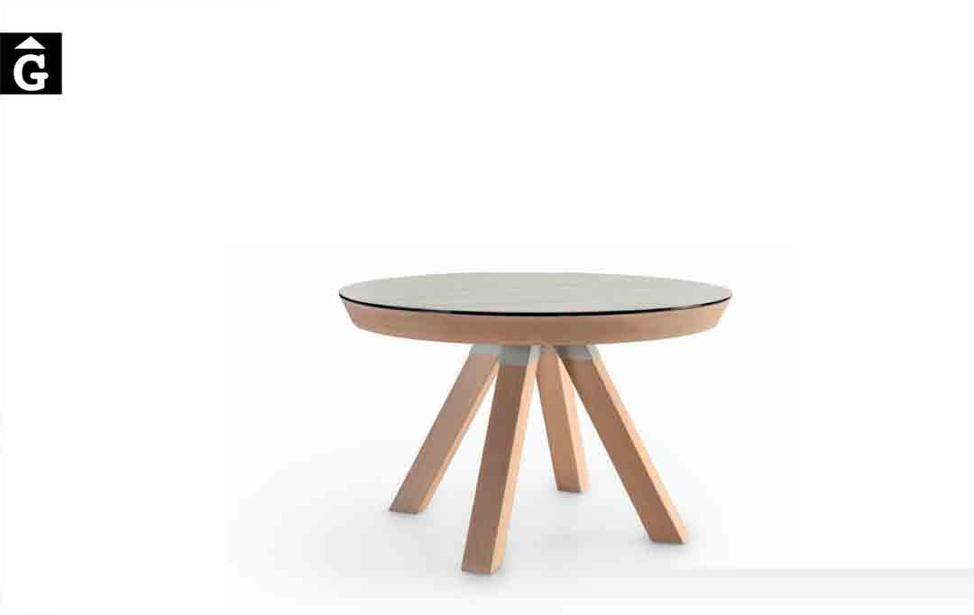 Taula-rodona-Water-extensible-sobre-Dekton-fons-blanc-Pure-Designs-mobles-Gifreu